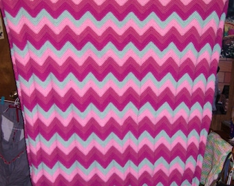Crocheted afghan in Strawberry Bubble Gum colors