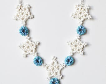 White and Blue Miyuki Seed Bead Geometric Snowflake Star Winter Necklace with Silver Coloured Chain and T-bar Clasp. 18Inch