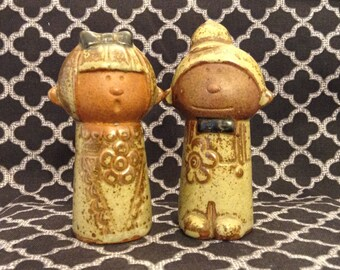 vintage stoneware couple salt and pepper shakers