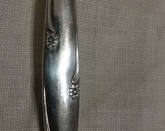1960 silver flowers pattern slotted serving spoon by community