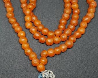Orange glass mala