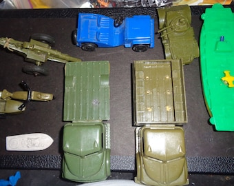 military vehicles and toy soldiers and other figures