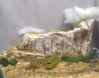 Mountain backdrop, Xmas village display, toy train layout.