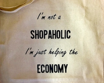 I'm not a Shopaholic, I'm Just Helping the Economy tote bag.