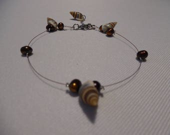 Bobbin on wire, Brown and beige, real shells and freshwater pearls.