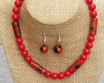 Red beads with painted accents