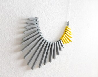 yellow grey geometric necklace, minimalist concept contemporary jewelry