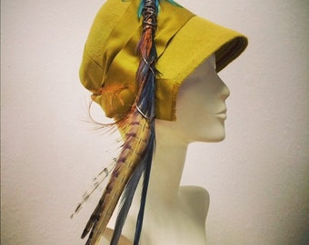 Peachbloom felt cloche with 'fishing fly' trim