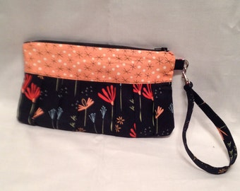 AK6- Compleat Clutch: in a smart flower print with pleated front, zipper closure and detatchable hand strap