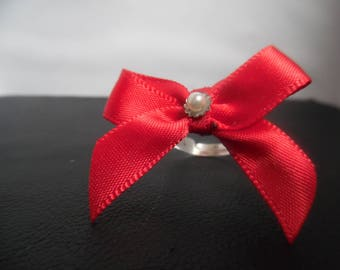 adjustable red bow and Pearl ring