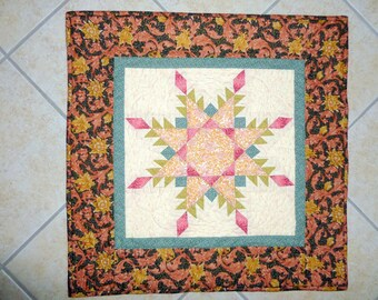 Hand quiltedQuilt wall hanging Feathered Star from William Morris Rose and Hubble design fabrics.
