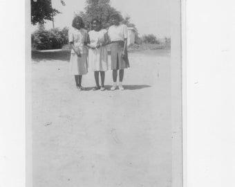 1930s  photograph of 3  African Americans girls on the playground at a one room school house a reprint from original photograph