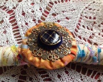 "Cabochon ring antique monte, print and ""yoyo"""
