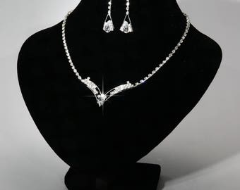 V shaped rhinestone necklace with matching earrings.