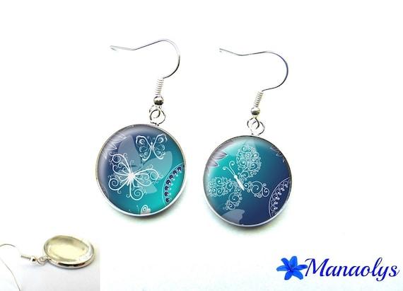Silver earrings studs glass white butterflies on blue background 2581