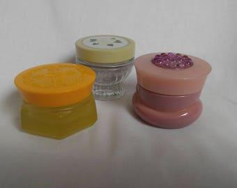 Set of three 1970s Avon perfume jars