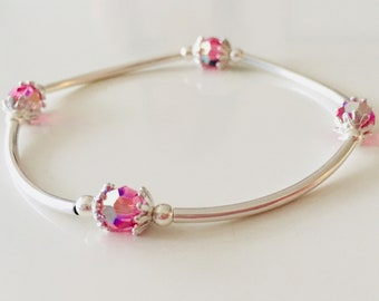 Sterling silver noodle bead and pink swarovski bead bracelet
