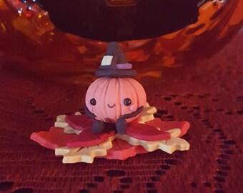 Pumpkin man with leaf stand