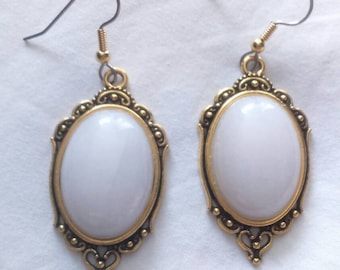 Neo baroque earrings, white marble cabochon attached surgical steel.