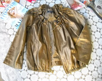 Metalic Gold Fine Leather Jacket by Anne Klein in size small features gathered neckline, ruffle collar, zip closure, front in seam pockets