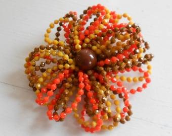 Plastic beaded flower brooch, pin.  Orange, large size.
