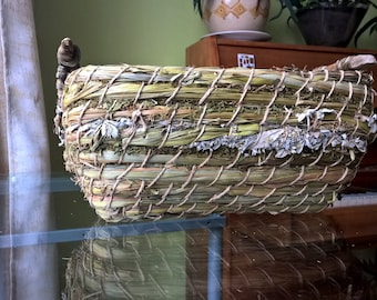 Herbal basket with sea stick and dry flowers