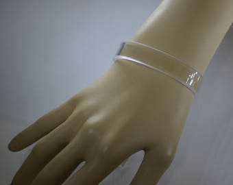 Acrylic Cuff Bracelet. Clear, Transparent. Easy Wearing-Rugged Plexiglass. Custom Fit to Wrist Measurement. Shows Natural Beauty of Skin.