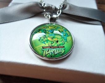 Teenage Mutant Ninja Turtles Keychain or Necklace | Michelangelo, Donatello, Raphael, Leonard, Ninja Turtles Gift, NYC, Fight Crime