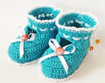 Crochet turquoise baby booties