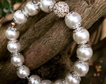 White pearl and Swarovski crystal charm bracelet. Hand made