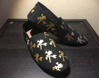 Joshua U2 Inspired Black and Gold Slip-Ons