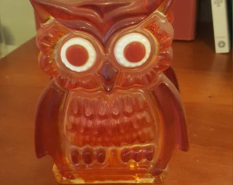 Kitschy orange owl napkin holder.