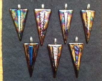 Iridescent triangular fused and dichroic glass pendant.