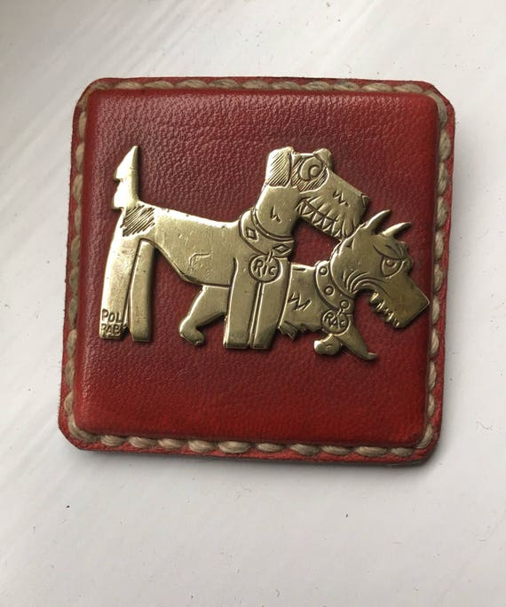 Rare Ric et Rac art deco brass and leather badge Pol Rab