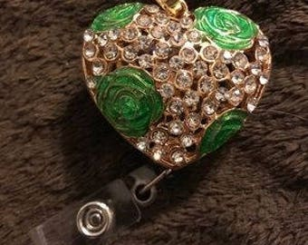 green flower heart badge reel