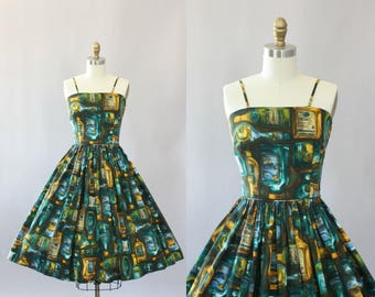 Vintage 50s Dress/ 1950s Cotton Dress/ Teal Alcohol Bottle Novelty Print Cotton Spaghetti Strap Dress XS