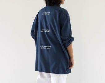 love is neither gift nor debt / blue button up shirt with white text / small-extra large
