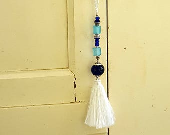 Pendacle to decorate your cabinets or drawers with glass bead and tassel trimmings
