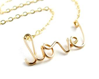 Gold love Necklace. 14k Gold Fill Cursive Script Love necklace