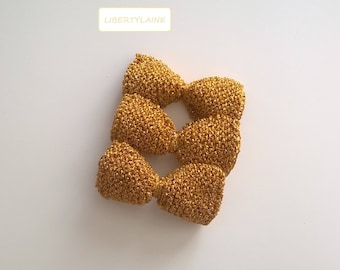 Trio of big bows knitted bright gold hand for customization