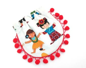 Squeeze coin pouch with red pom pom fringe trim, mini bag, children of the world, round flex frame purse