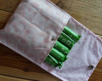 Sanitary pad/towel/tampon/incontinence  pouch/ purse. Keeps everything together to prevent scrambling around in your bag.  pink