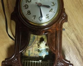 Vintage mastercrafters girl swings working clock