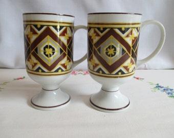 Two Holt Howard Mid Century Pedestal Mugs