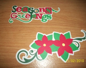 Seasons greetings title with poinsettia