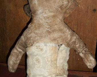 Solemn a Very Primitive Doll