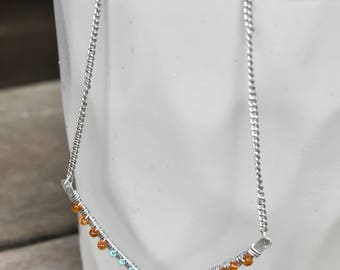 Karina Necklace// blue and orange beads on hammered metal