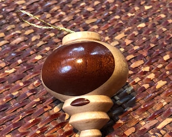 Wood carved, handmade, one of a kind ornament.