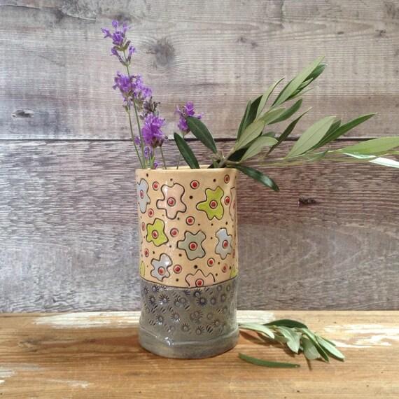 Handmade ceramic vase, richly patterned, vintagey feel, flower pattern