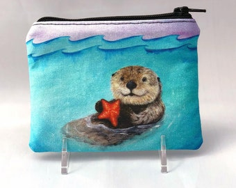 Sea Otter Serenity - Small Zipper Pouch - Adorable Otter floating in ocean with orange starfish - Art by Marcia Furman